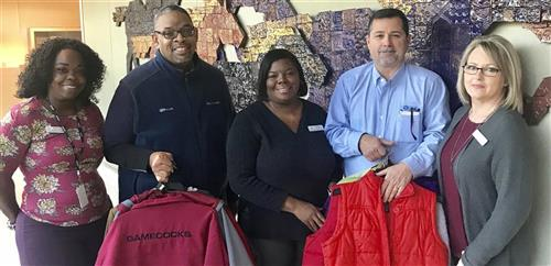 Donating coats to keep students warm