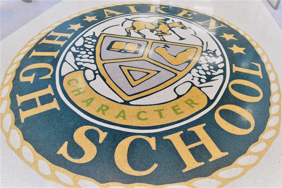 The Aiken High School seal placed at the entrance of the school's new administration building