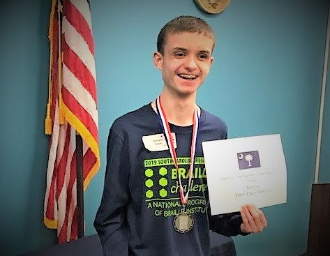 LMMS Student Brenson Baker Wins First Place Award in Braille Challenge