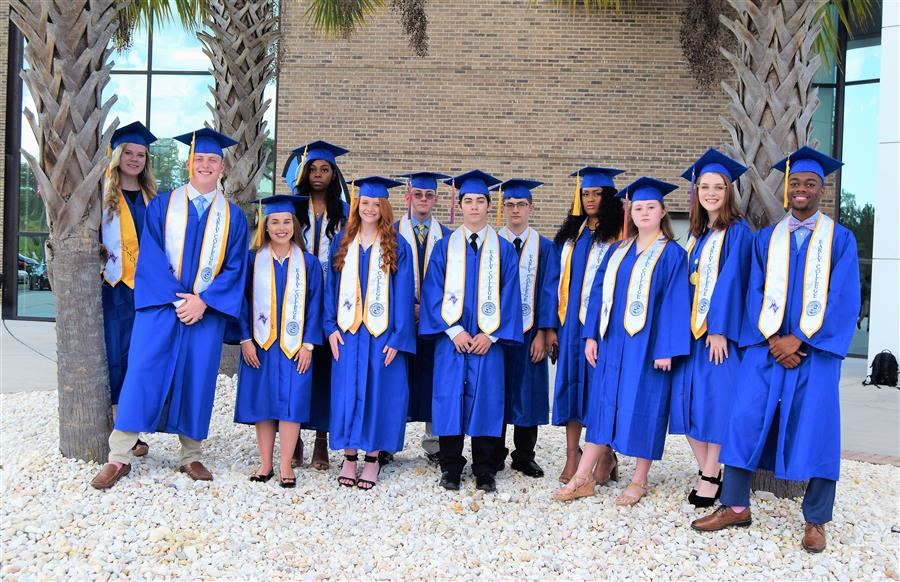 Early College Program graduates pose for a picture outside the USC Aiken Convocation Center