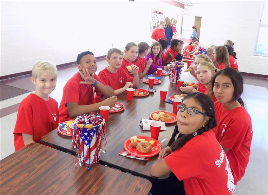 Student Ambassadors eat breakfast before the Veteran's Day Program