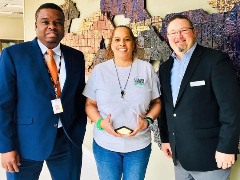 Carl White and Angela Gibson receive the 2019 United Way School Of The Year Award