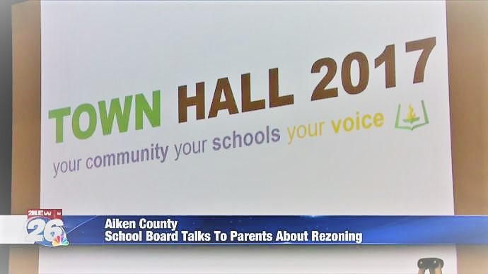 News Channel image shows presentation slide during town hall meeting