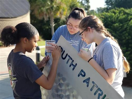 Scholars Volunteer for a Day of Service