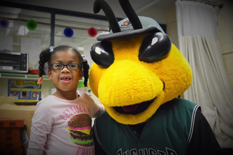 Augusta GreenJackets Mascot Auggie poses for a picture with student Sarah Teagan Roberson
