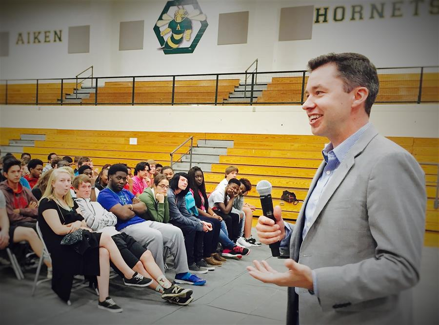 STEM Premier COO Casey Welch speaks with Aiken High students